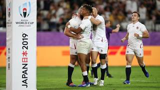 England's Anthony Watson celebrates with team mates scoring their fourth try REUTERS/Peter Cziborra