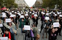 People attend a demonstration against femicide and violence against women at Place de la Republique in Paris