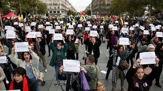 People attend a demonstration against femicide and violence against women at Place de la Republique in Paris