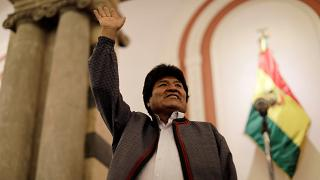 Evo Morales reacts after the results for the first round of the country's presidential election were announced