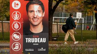 A man walks past a Justin Trudeau sign in the Papineau area of Montreal, Quebec, Canada October 20, 2019.