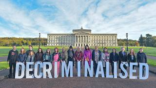 Campaigners mark the decriminalisation of abortion in Northern Ireland outside Stormont, in a demonstration organised by Amnesty International.