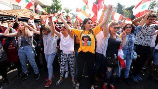 متظاهرات لبنانيات خلال مسيرة أمس الأحد