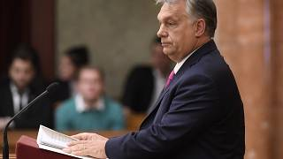 Hungarian opposition MP holds 'lies' sign during Orban's parliament speech