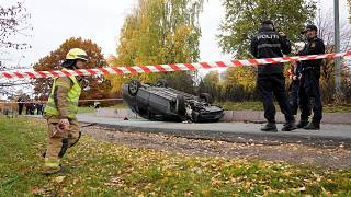 An overturn car is seen on the road, after it was allegedly struck by an ambulance which was stolen by an armed man in Oslo, Norway, October 22, 2019.