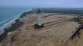 Danish lighthouse moved to save it from coastal erosion