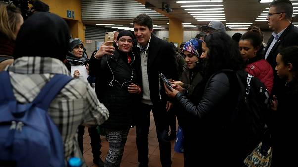 Canadian PM Justin Trudeau takes selfies with subway users in Montreal
