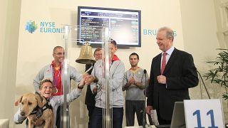 FILE PHOTO: Belgian athlete Marieke Vervoort rings a bell in the presence of fellow athletes, 2012s