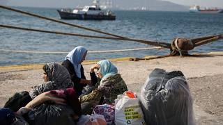 Refugees and migrants wait to be transferred to camps on the mainland, at the port of Elefsina near Athens Greece, October 22, 2019.