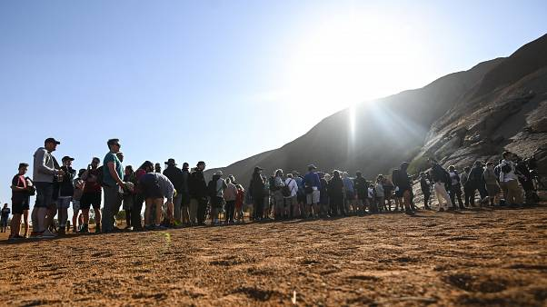 Tourists are seen climbing Uluru, formerly known as Ayers Rock, at Uluru-Kata Tjuta National Park in the Northern Territory, Australia, October 25, 2019.