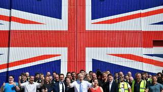 Conservative leadership candidate Boris Johnson poses for a photograph with workers at the Wight Shipyard Company at Venture Quay during a visit to the Isle of Wight, Britain