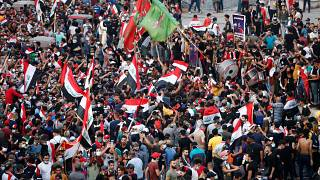 Demonstrators take part in a protest over corruption, lack of jobs, and poor services, in Baghdad