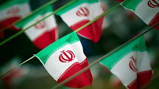 أعلام إيران- أرشيف رويترز