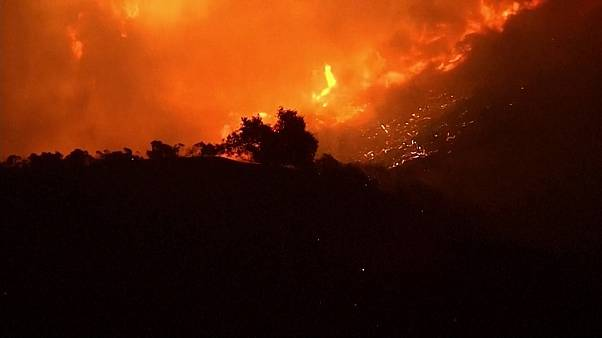 Thousands ordered to flee fast-moving Los Angeles wildfire