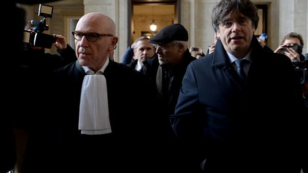 Former Catalan leader Carles Puigdemont arrives at court for his warrant case