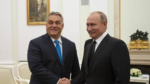 FILE PHOTO: Hungarian Prime Minister Viktor Orban (L) shakes hands with Russian President Vladimir Putin during their meeting in the Kremlin in Moscow, on September 18, 2018.
