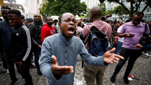 Refugees and police clash at Cape Town protest against xenophobia