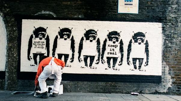 A picture, supposedly of elusive British artist Banksy at work
