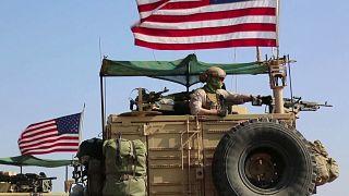 Vehicles flying US flags seen near Syria-Turkey border