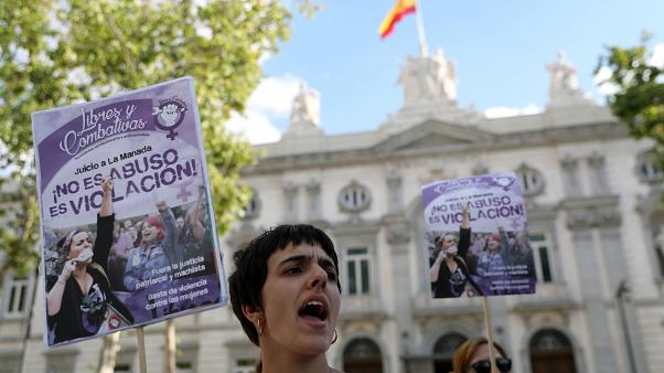 """FILE PHOTO: Women gather outside the Supreme Court after Spain's top court found five men known as the """"Wolf Pack"""" guilty of rape in Madrid, Spain, June 21, 2019."""