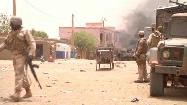 FILE:  Soldiers stand guard as smoke rises in the distance after a car bomb attack in Gao, northern Mali July 1, 2018.