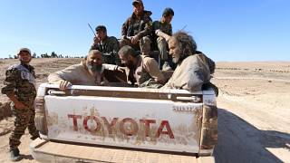FILE PHOTO: Three men that Democratic Forces of Syria fighters claimed were jihadist fighters sit on a pick-up truck while being held as prisoners, Syria, February 18, 2016