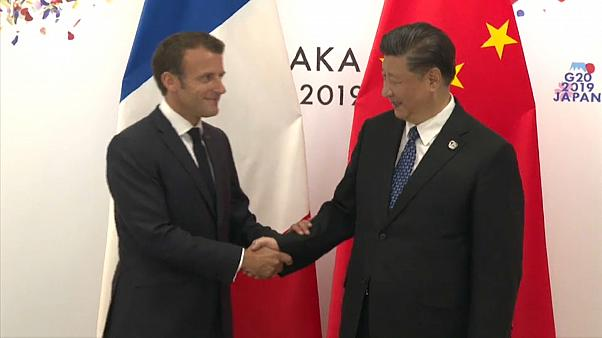 Macron in China: French president to discuss trade, climate with Xi Jinping