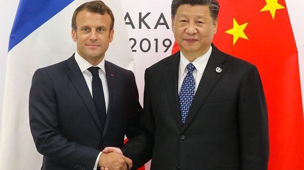 """الصين تستقبل """"الصديق"""" ماكرون وتحذر من فتح ملف هونغ كونغ"""
