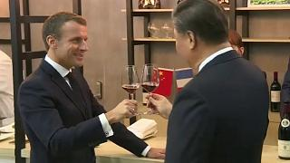 Macron and Xi clink glasses during the French president's state visit to China