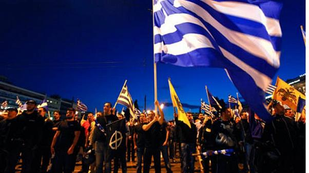 Supporters of the extreme-right Golden Dawn party sing the national anthem