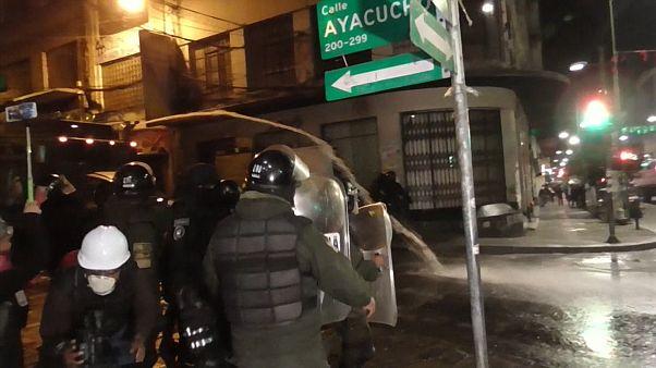 Police and protesters clash in Bolivia's La Paz