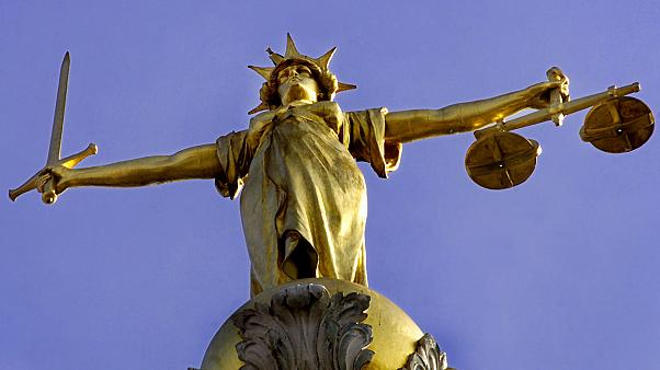 A statue over the Old Bailey court in central London.