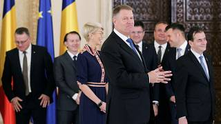 Romanian President Klaus Iohannis smiles as he adresses the audience at the end of the swearing-in ceremony of the Orban cabinet at the Cotroceni presidential palace