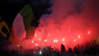 Lazio fans light flares before the match against Celtic on November 7.