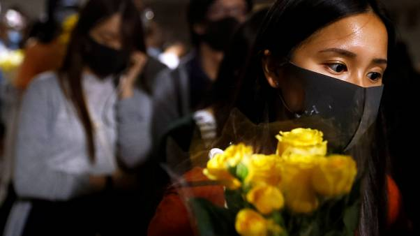 A woman pays tribute with flowers to Chow Tsz-lok, 22, a university student who died after he fell during a protest in Hong Kong, China, November 8, 2019.