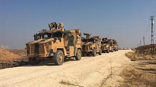 Turkish military vehicles are seen on the Turkish-Syrian border before a joint Turkish-Russian patrol in northeast Syria.