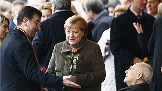 Törene katılan Almanya Başbakanı Angela Merkel, İBB Başkanı Ekrem İmamoğlu bir süre sohbet ett