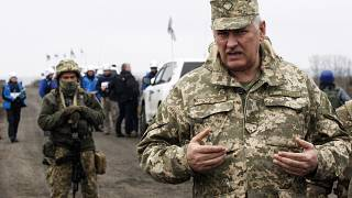 Senior Ukrainian army representative, Bogdan Bondar, speaks to the press during the withdrawal of the Ukrainian forces near Bogdanivka village