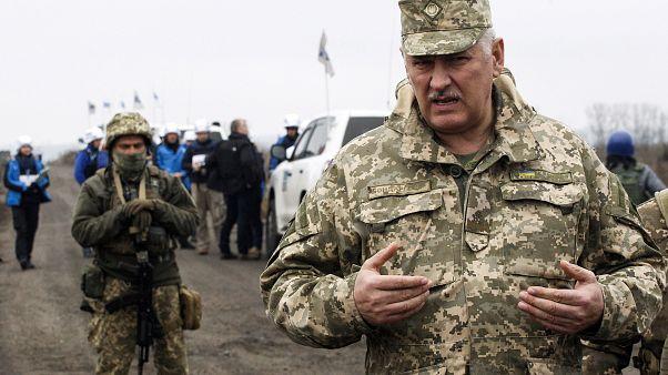 Senior Ukrainian army representative, Bogdan Bondar, speaks to the press during the withdrawal of the Ukrainian forces near Bogdanivka village