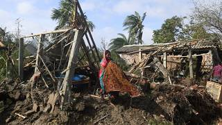 A woman cleans her house damaged by Cyclone Bulbul in Bakkhali on November 10, 2019
