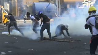 Iraqi security forces clash with anti-government protesters in Baghdad