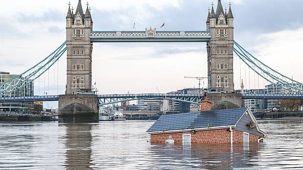 "Extinction Rebellion floats British house mock-up ""sinking"" in Thames in climate protest"