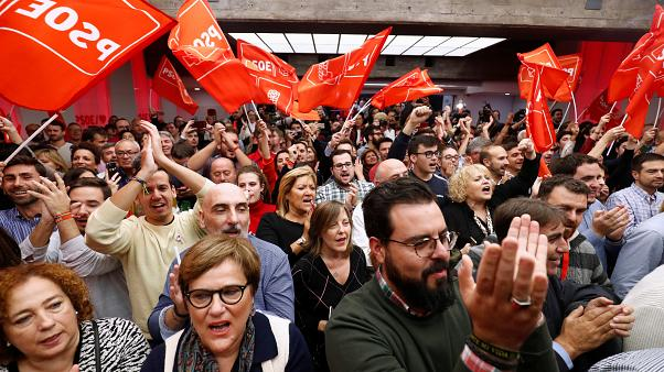 Supporters of Spain's acting Prime Minister and Socialist Party leader (PSOE) candidate Pedro Sanchez react during Spain's general election at party headquarters in Madrid.