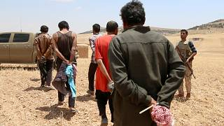 Men, who the Democratic Forces of Syria fighters claimed were Islamic State fighters, taken prisoners in Aleppo Governorate, Syria May 31, 2016.
