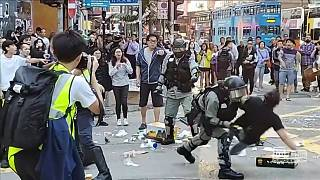 Hong Kong police shoot protester as chaos erupts across city