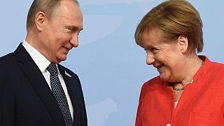 Vladimir Putin ve Angela Merkel