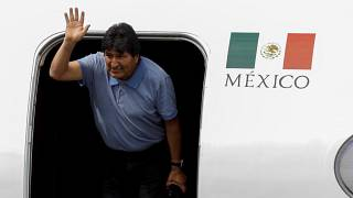Bolivia's ousted President Evo Morales waves during his arrival to take asylum in Mexico City, Mexico, November 12, 2019