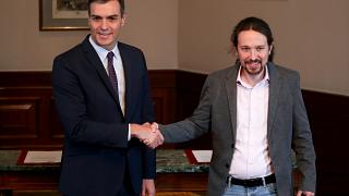Spanish acting Prime Minister Pedro Sanchez and Unidas Podemos (Together We Can) leader Pablo Iglesias shake hands during a news conference at Spain's Parliament in Madrid