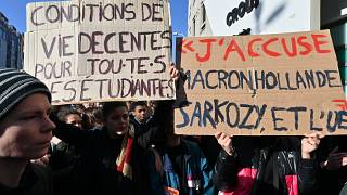 Students protest outside a campus building after a 22-year-old man set himself alight over financial problems, Lyon, France, November 12, 2019.