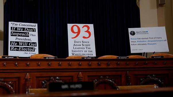 Signs are placed behind seats of committee members at a House Intelligence Committee hearing as part of the impeachment inquiry into U.S. President Donald Trump